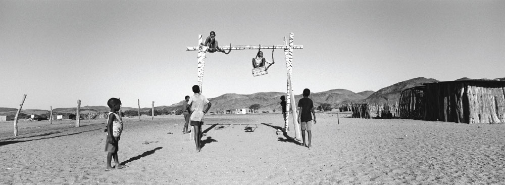 Namibian kids play in playground