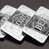 Three ten ounce collectible silver bars stacked lengthways and decorated with text 1 bourbon 1 scotch and 1 beer